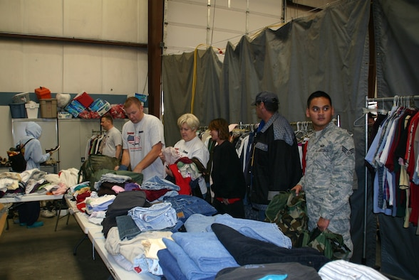Volunteers at the Sooner Stand Down help homeless veterans find clothing and shoes to fill their backpacks. Photo courtesy of 1Lt Kinder Blacke.