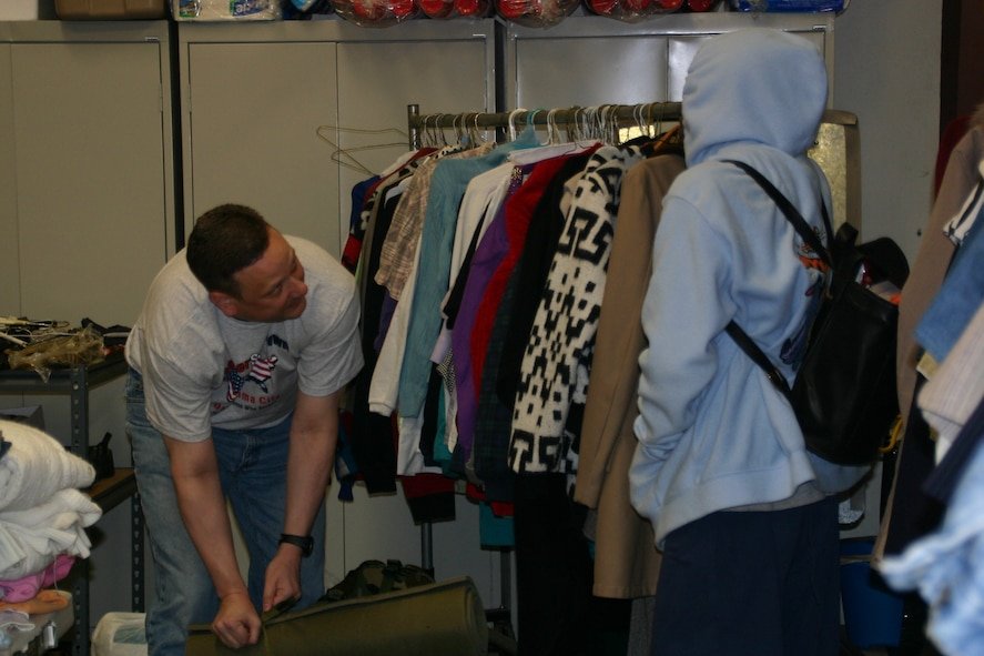 Maj. Craig Tayman, 552nd Training Squadron, talks to one of the veterans as he closes her backpack full of clothing and necessities. Photo courtesy of 1Lt Kinder Blacke.