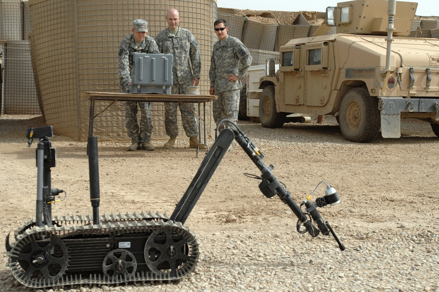 KIRKUK REGIONAL AIR BASE, Iraq – 506th Air Expeditionary Group Explosive Ordnance Disposal flight members Senior Airman Aaron Skelton, Tech. Sgt. Stephen Ray Hunter Jr. and Senior Airman Joshua Brum, run a function check on a TALON robot Sept 14. The teams use the robot to recon and disable roadside bombs. Six Kirkuk RAB EOD Airmen are forward deployed to FOB McHenry where they are embedded with soldiers of the Army's 10th Mountain Division. (U.S. Air Force photo/Tech. Sgt. Jeff Walston)