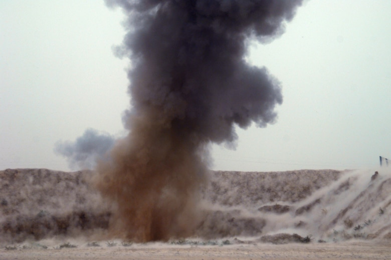 KIRKUK REGIONAL AIR BASE, Iraq – A controlled detonation at FOB McHenry by members of the 506th Air Expeditionary Group Explosive Ordnance Disposal flight destroys insurgent ordnance Sept 15.  Six 506th EOD Airmen are embedded with soldiers of the Army's 10th Mountain Division at FOB McHenry where they perform route clearance duties. (U.S. Air Force photo/Tech. Sgt. Jeff Walston)