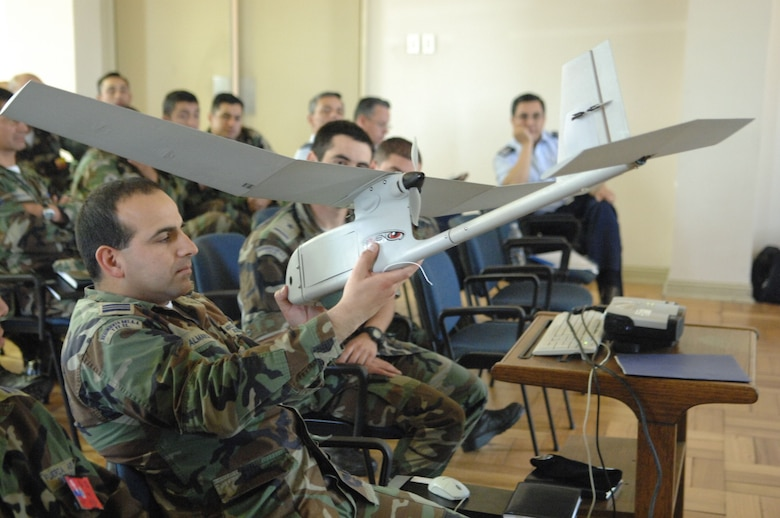 Chilean airmen examine a U.S. Air Force unmanned aerial system Oct. 29 at Quintero Air Base, Chile during an information exchange for Operation Southern Partner. The two-week operation is an in-depth, subject-matter exchange emphasizing partnership, cooperation and sharing of information with partner nation Air Forces in Latin America. (U.S. Air Force Photo/Tech. Sgt. Roy Santana)