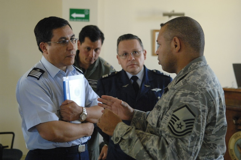 Master Sgt. Edward Nin, a force protection noncommissioned officer from 12th Air Force at Davis Monthan Air Force Base, Ariz., discusses highlights of an Oct. 29 Operation Southern Partner subject matter exchange with the Chilean air base chief of security forces Col. Randot Espinoza, while the group Commandant, Col. Anselmo Salas (center) looks on. Operation Southern Partner is an in-depth, two-week subject matter exchange emphasizing partnership, cooperation and sharing of information with partner nation Air Forces in Latin America. (U.S. Air Force Photo/Tech. Sgt. Roy Santana)