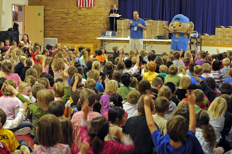 """Sammy Rabbit"" and Sam Renick, author of the book, ""It's A Habit, Sammy Rabbit!"" teach children how to be financially responsible at Badger Clark Elementary, S.D., Oct. 30. Mr. Renick sang songs, told stories and discussed the importance of saving money. (U.S. Air Force photo by Airman Corey Hook)"