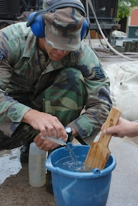 SOTO CANO AIR BASE, Honduras - Air Force Tech. Sgt. Shane Bolles, works on purifying the well water Oct. 29. After only a few days, the servicemembers have purified more than 2,500 gallons of drinking water from the flood affected community. (U.S. Army photo by Specialist Ethan Anderson)