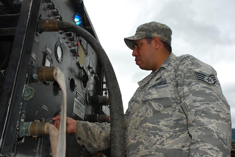 SOTO CANO AIR BASE, Honduras - Air Force Staff Sgt. Nick Luna, deployed from Dyess Air Force Base, Texas, works on a water filtration machine Oct. 29. Servicemembers from Joint Task Force-Bravo are participating in a 10-day operation in a nearby community to filter well water. The well water became undrinkable after more than a week long stretch of rain caused flooding in the area. (U.S. Army photo by Specialist Ethan Anderson)