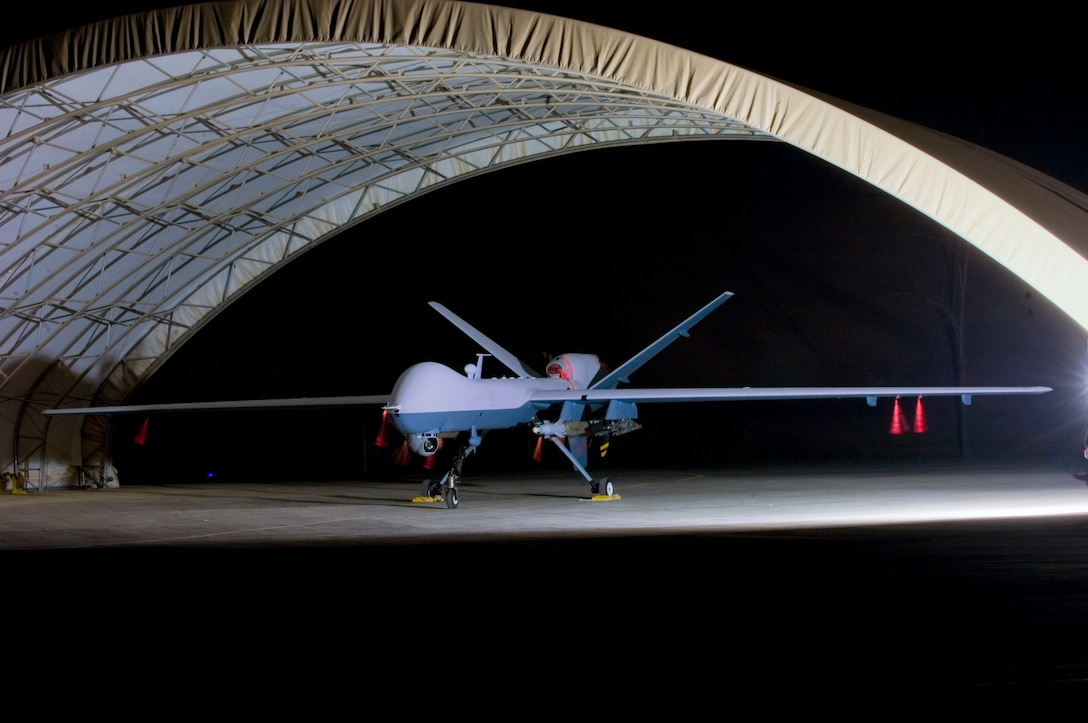 An armed MQ-9 Reaper unmanned aircraft sits in a shelter Oct. 15 at Joint Base Balad, Iraq, before a mission. Larger and more powerful than the MQ-1 Predator, the Reaper can carry up to 3,750 pounds of laser-guided bombs and Hellfire missiles. (U.S. Air Force photo/Tech. Sgt. Erik Gudmundson)