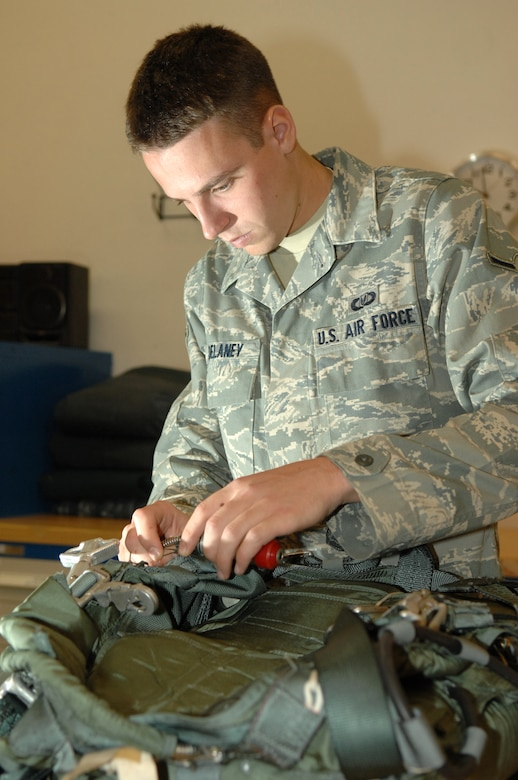 Airman Justin Delaney, 563rd Operations Support Squadron aircrew flight equipment, performs an inspection on a parachute to ensure serviceability here, October 30. (U.S. Air Force photo/Senior Airman Noah R. Johnson)