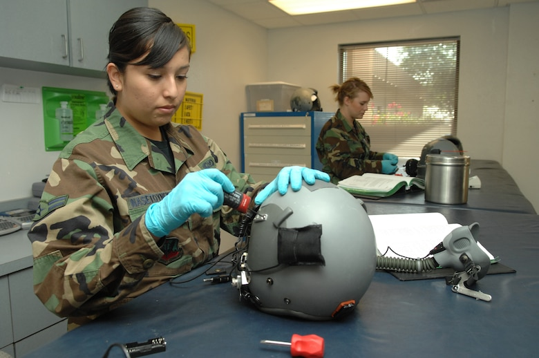 Airman 1st Class Trudy Nasetoynewa, 563rd Operations Support Squadron aircrew flight equipment, inspects a MBU-12P mask to ensure serviceability here, October 30. (U.S. Air Force photo/Senior Airman Noah R. Johnson)