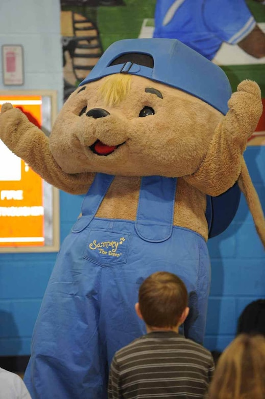 "Sammy Rabbit, main character in the book by Sam Renick, ""It's A Habit, Sammy Rabbit!"" visits with Ellsworth children about financial responsibility here, Oct. 30. Mr. Renick sang songs, told stories and discussed the importance of saving money. (U.S. Air Force photo/Airman 1st Class Adam Grant)"