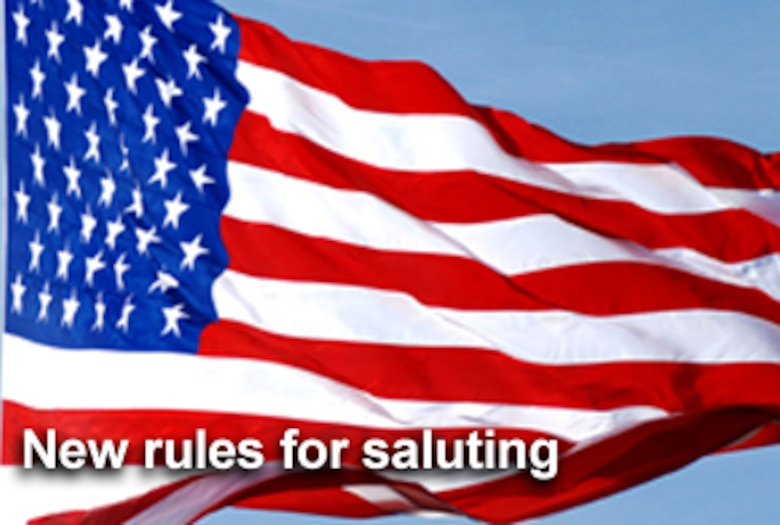 Veterans and servicemembers not in uniform now can render the military-style hand salute during the playing of the national anthem, because of changes in federal law that took effect in October. (U.S. photo illustration/Mike Carabajal)