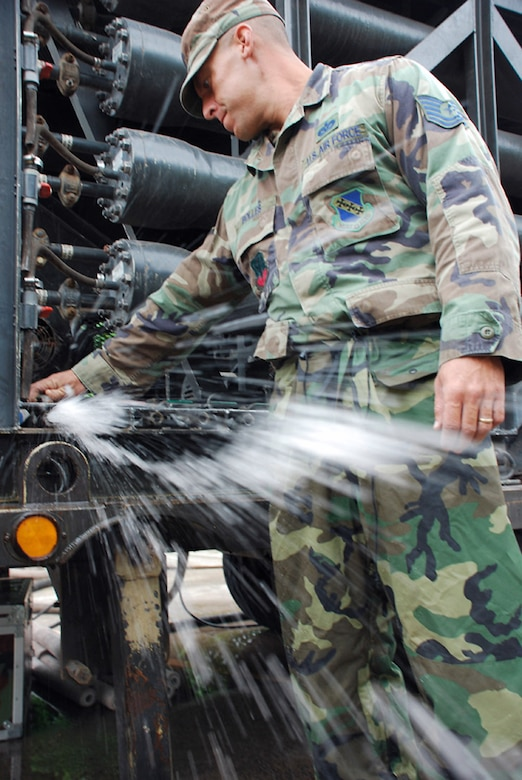 Tech. Sgt. Shane Bolles works on a water filtration machine Oct. 29 at La Paz, Honduras. Servicemembers from Joint Task Force-Bravo are participating in a 10-day operation in a nearby community to filter well water. The well water became undrinkable after more than a weeklong stretch of rain caused flooding in the area. Sergeant Bolles is assigned to Soto Cano Air Base, Honduras, deployed from Dyess Air Force Base, Texas. (U.S. Air Force photo/Staff Sgt. Joel Mease)