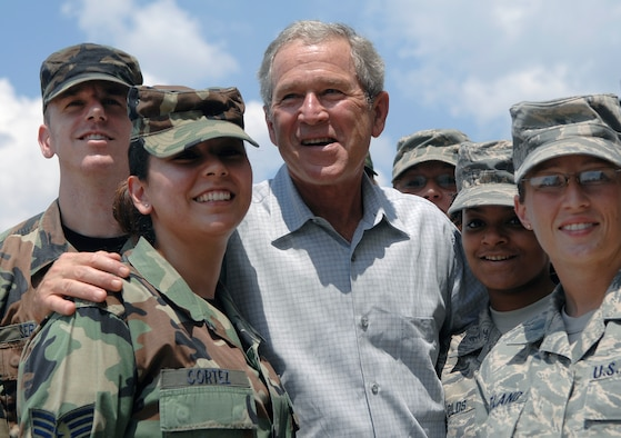 President George W. Bush poses with Airmen from the 59th Medical Wing and Texas Air National Guard 149th Fighter Wing who volunteered to help process over 700 evacuees of Hurricane Gustav at Port San Antonio Sept 1. 