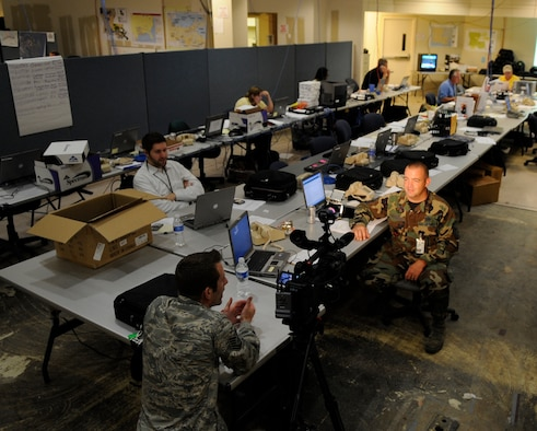 Tech. Sgt. Lee Hoover, an Air Force News Agency broadcaster, interviews Master Sgt. Glenn Coughlin Sept. 1 at the Hurricane Gustav Joint Field Office in Baton Rouge, La.  Sergeant Coughlin, with the Louisiana Air National Guard's 159th Fighter Wing at Naval Air Station Joint Reserve Base-New Orleans just north of New Orleans, is a logistics supply specialist assigned to assist Federal Emergency Management Agency officials during evacuation and relief efforts.    (U.S. Air Force photo/Staff Sgt. Shawn Weismiller)