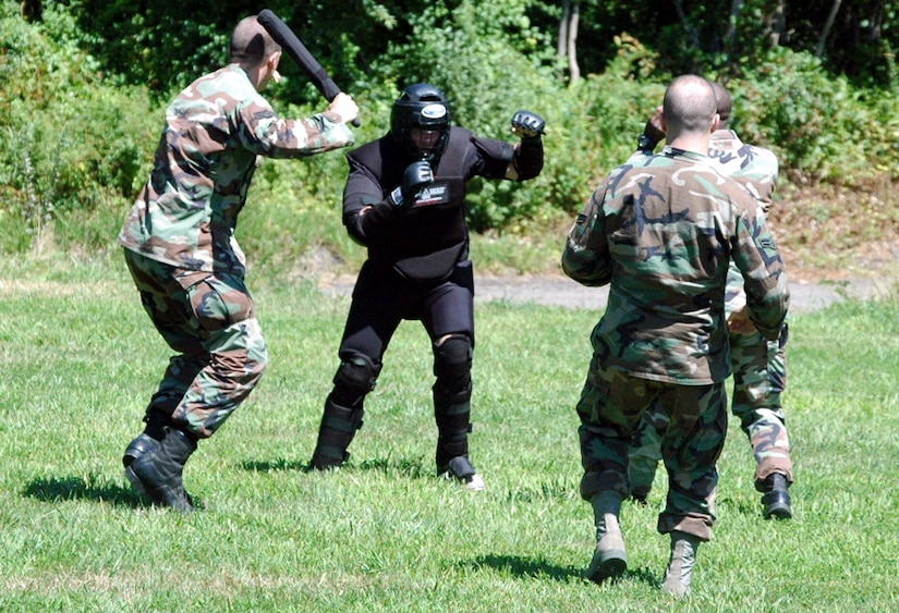 """Students in the Air Force Phoenix Raven Course, fight back an """"attacker"""" during an evaluation session in the course on a Fort Dix, N.J., range Aug. 20, 2008.  The course, taught by the U.S. Air Force Expeditionary Center's 421st Combat Training Squadron, trains security forces Airmen to become Ravens where they specialize in protecting Air Force aircraft in austere environments.  (U.S. Air Force Photo/Tech. Sgt. Scott T. Sturkol)"""