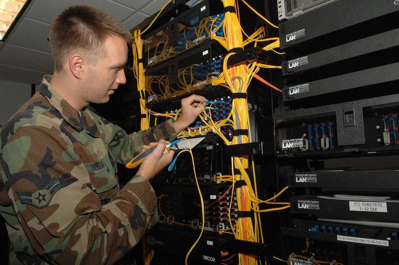 Airman 1st Class Austin Weltha conducts a light test on a fiber optic cable.  Airman Weltha is a network management apprentice with the 355th Communications Squadron.  (U.S. Air Force photo by Senior Airman Alesia Goosic)