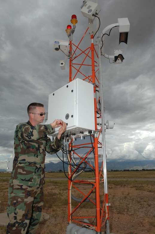 Staff Sgt. William Fish installs a new fiber optic modem for the FMQ-19 weather equipment.  Sergeant Fish is the NCOIC of Airfield Systems with the 355th Communications Squadron.  (U.S. Air Force photo by Senior Airman Alesia Goosic)