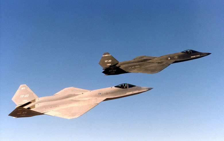 The two Northrop-McDonnell Douglas YF-23 prototypes in flight. The aircraft on display at the National Museum of the United States Air Force is the darker one on the right. (U.S. Air Force photo)