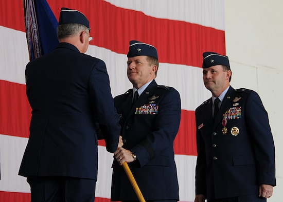 ANDERSEN AIR FORCE BASE, Guam - Lieutenant Gen. Chip Utterback, 13th Air Force commander, presents Brig. Gen. Philip Ruhlman with the 36th Wing guidon signifying the change of command Sept. 2 here. General Ruhlman arrives here from Joint Warfare, Supreme Allied Command Transformation, Stravenger, Norway where he was the Chief of Staff.  (U.S. Air Force by Staff Sergeant Jamie Lessard)