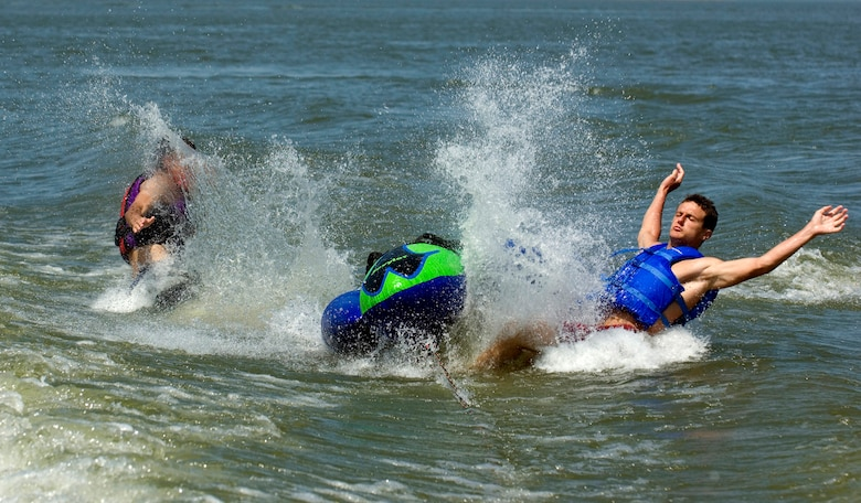 Horror at Harkers Island - With their tube buckled in a wake while being pulled by a boat, a man and a 1-year-old boy were catapulted into the air and collided. The man was knacked out. (photo by Tech. Sgt. Matthew Hannen)