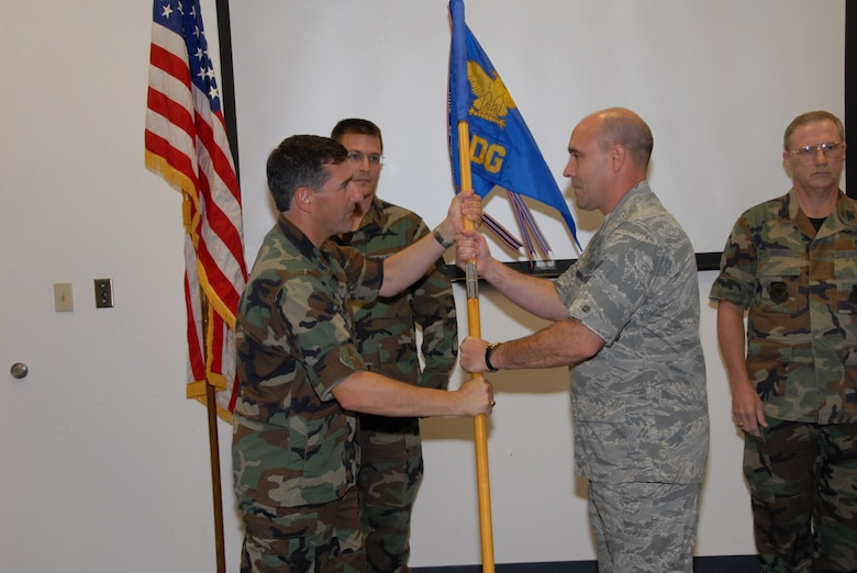 SCOTT AIR FORCE BASE, Ill. - Lt. Col. Jon Boehning accepts the guideon and command of the 126th Medical Group from Col Peter Nezamis, commander of the 126th Air Refueling Wing, as Master Sgt. Mark Teigland, the 126 MDG first sergeant looks on.  (U.S. Air Force photo by Tech. Sgt. Mike Rice)