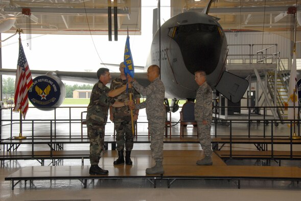 SCOTT AIR FORCE BASE, Ill. - Lt. Col. Rick Keasey accepts the guideon and command of the 126th Maintenance Group from Col. Peter Nezamis, commander of the 126th Air Refueling Wing, as Chief Master Sgt. Mark Berens, the 126 MXG quality assurance chief ,looks on.  (U.S. Air Force photo by Master Sgt. Franklin Hayes)