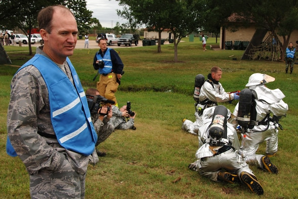 Lt. Col. Clint Burpo (far left) watches Air Force and local emergency response personnel evacuate simulated crash victims during a major accident response exercise just outside McConnell Air Force Base, Kan., on Sept. 3. The exercise was coordinated by the 22nd Air Refueling Wing, the 931st's host wing at McConnell. Colonel Burpo, an air reserve technician assigned to the 931st Air Refueling Group's Plans and Programs office, helped the 22nd ensure safety during the exercise was not unnecessarily compromised on a cold and rainy day.