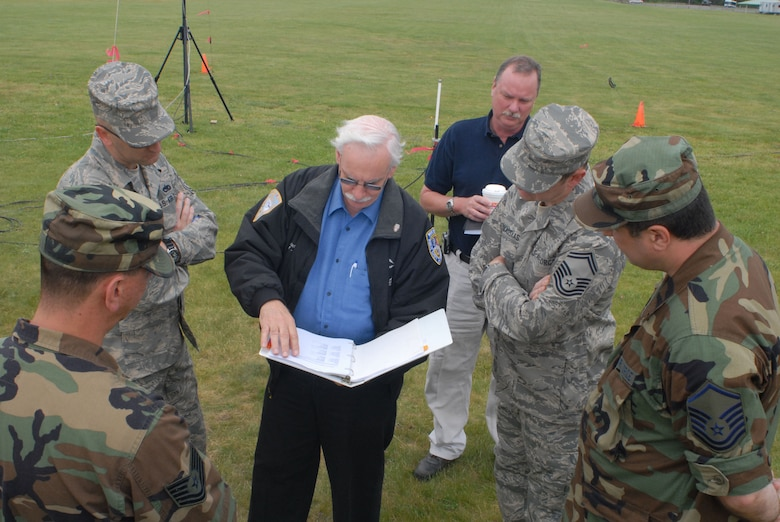 Keith Victor (center), Chairman, and Chris Marvin (center right), Co-Chair, for Region 3 of the Capital Region Emergency Planning Committee, coordinate with members of the Connecticut National Guard's Joint Incident Site Communication Capability (JISCC) team at Camp Rell, Niantic, Connecticut on June 5, 2008.  The planning session is part of the effort to link the JISCC system to the capital region's four mobile command posts.  Linking the systems allows local and state emergency services to coordinate with Army and Air National Guard resources to aid in disaster relief efforts. (U.S. Air Force photo by Staff Sgt. Nicholas A. McCorkle)