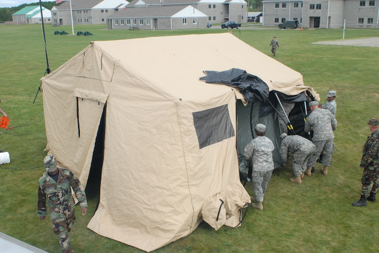 A joint team of Army and Air National Guard personnel set up the Joint Incident Site Communication Capability (JISCC) tent during the June 5, 2008 deployed training exercise at Camp Rell, Niantic, Connecticut. The JISCC is able to arrive at an incident site, and rapidly provide global communications to on-scene commanders, including satellite communications, video teleconferencing, secure voice transmissions, and internet capabilities. (U.S. Air Force photo by Staff Sgt. Nicholas A. McCorkle)