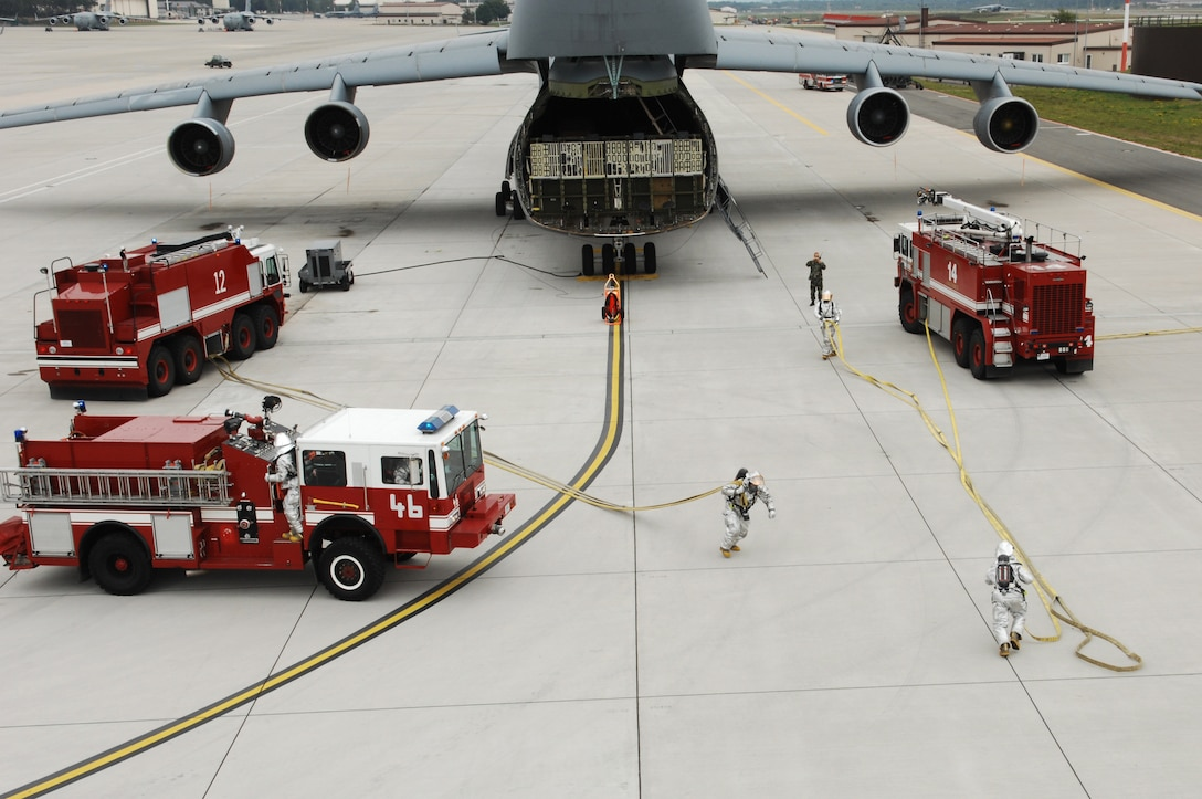 "United States Air Force firefighters from the 835th Civil Engineering Squadron prepare to rescue ""casualties"" from a C-5 Galaxy aircraft during a mass casualty exercise, Aug. 29, 2008, Ramstein Air Base, Germany. The 835th CES holds a mass casualty exercise monthly to keep Air Force firefighters sharp and up to date with training. (U.S. Air Force photo by Senior Airman Amber Bressler)(RELEASED)*"
