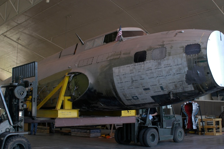 "DAYTON, Ohio -- Restoration crews work together to unload the fuselage of the B-17D ""The Swoose"" that recently arrived at the National Museum of the U.S. Air Force from the National Air and Space Museum. (U.S. Air Force photo)"