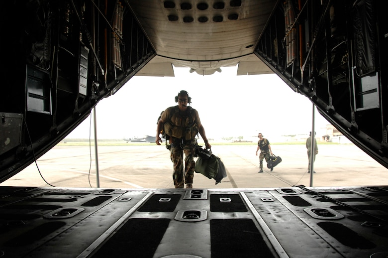 Tech. Sgt. Luigge Romanillo, 129th Rescue Wing pararescueman, embarks on an MC-130P Combat Shadow in Meridian, Miss., Sept. 3. Sergeant Romanillo was on search and rescue alert in Mississippi and returned to Ellington Field, Texas. More than 80 Airmen from the 129th RQW deployed to Ellington Field, Texas, as part of Joint Task Force 129, which supported Hurricane Gustav rescue operations. Air National Guardsmen from the 106th Rescue Wing, Gabreski Airport, N.Y., and 176th Wing, Kulis Air National Guard Base, Alaska, were also part of the rescue task force. (U.S. Air Force photo by Tech. Sgt. Ray Aquino)