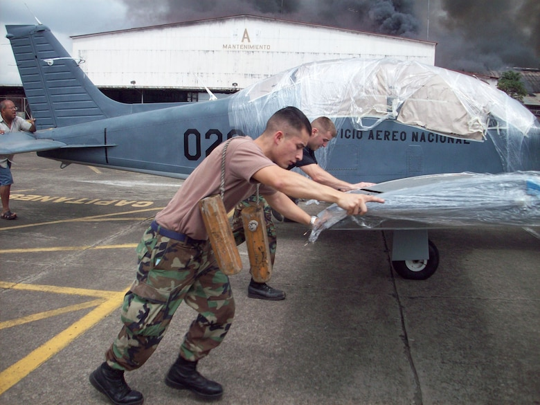 U.S. servicemembers participating in a multinational exercise near Panama City, Panama, August 25, aided Panamanian ground forces in saving civilian and military aircraft from destruction after a fire engulfed an aircraft hangar at the military section of the Tocumen International Airport.  More than 45 U.S. Airmen, Sailors and Soldiers,  along with military and civilians from 21 countries, arrived here in early August to participate in Fuerzas Aliadis PANAMAX 2008, a U.S. Southern Command sponsored exercise that focuses on ensuring the defense of the Panama Canal – a strategic and economically crucial waterway.