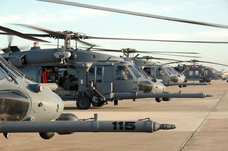 A line of HH-60G Pave Hawks from the 943rd Rescue Group, Davis-Monthan Air Force Base, Ariz., 176th Wing, Kulis Air National Guard Base, Alaska, and 129th Rescue Wing, Moffett Federal Airfield, Calif., sit on the flightline at Ellington Field, Texas, Sept. 3. The U.S. Air Force and Air National Guard aircraft and personnel provided the governors of Louisiana and Texas air search and rescue assets for the response to Hurricane Gustav. (U.S. Air Force photo by Technical Sgt. Ray Aquino)