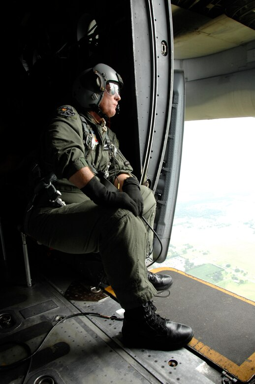 Chief Master Sgt. Ken Huntley, 129th Rescue Wing loadmaster, waits for the HH-60G Pave Hawk to link up with the MC-130P Combat Shadow during an aerial refueling over Louisiana.  More than 80 Airmen from the 129th RQW deployed to Ellington Field, Texas, as part of Joint Task Force 129, which supported Hurricane Gustav rescue operations. Air National Guardsmen from the 106th Rescue Wing, Gabreski Airport, N.Y., and 176th Wing, Kulis Air National Guard Base, Alaska, were also part of the rescue task force. (U.S. Air Force photo by Tech. Sgt. Ray Aquino)
