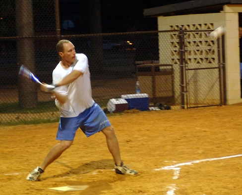 Christopher Palmer, 14th Operational Support Squadron, prepares to swing at a pitch during the intramural softball championship game Wednesday at Field One. The final game was between the 14th OSS and the 14th Civil Engineer Squadron. Ultimately, the championship title was given to the 14th CES after defeating the 14th OSS with a score of 17-3. (U.S. Air Force photo by Airman Josh Harbin)