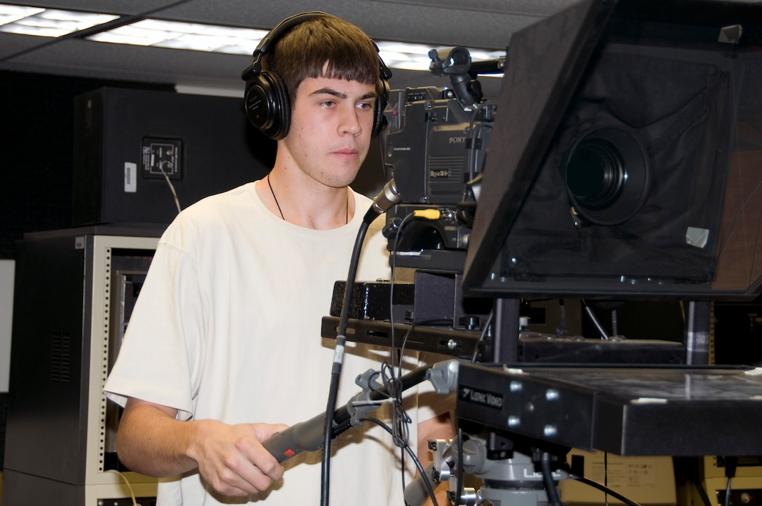 Ethan Halliday operates the camera during a filming session as part of his duties as a student intern with the Air Force Operational Test and Evaluation Center. The program partners AFOTEC with the University of New Mexico to recruit students and expose them to government service, particularly in shortage career fields.