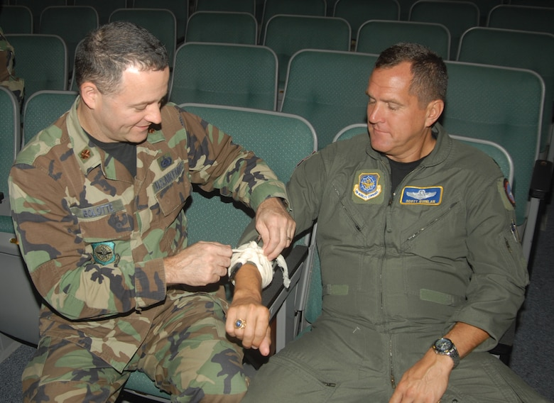 Maj. Armand Bolotte and Lt. Col. Scott Quinlan of 123rd Airlift Wing Headquarters, practice self-aid and buddy care skills. (Photo by Capt. John Stamm/KyANG)