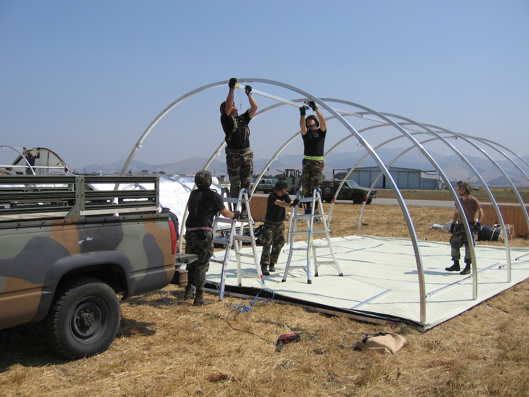 Members of the Kentucky Air Guard's 123rd Contingency Response Group erect shelters during a deployment to California in July as part of an exercise to test the Air Force's emergency airlift and reaction capabilities.