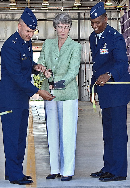 At the ribbon cutting for the new corrosion control facility here are, from left to right, Col. Eric Kivi, 58th SOW commander; Congresswoman Heather Wilson; and Lt. Col. Leon Dockery, 58th Maintenance Squadron commander. U.S. Air Force photo by Helga Carter