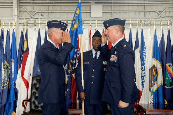 Col. Lawrence Martin takes command of the 6th Air Mobility Wing during the wing's change of command ceremony Monday. Col. Martin comes to MacDill from an assignment as the vice commander of the 379th Air Expeditionary Wing, Southwest Asia.  (U.S. Air Force photo by Staff Sgt. Joseph Swafford)