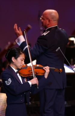 Air Force Strings Concertmaster TSgt Mari Uehara performs an stirring violin solo accompanied by the United States Air Force Orchestra.  The concert was part of the USAF Band's Guest Artist Series at DAR Constitution Hall in Washington, DC.