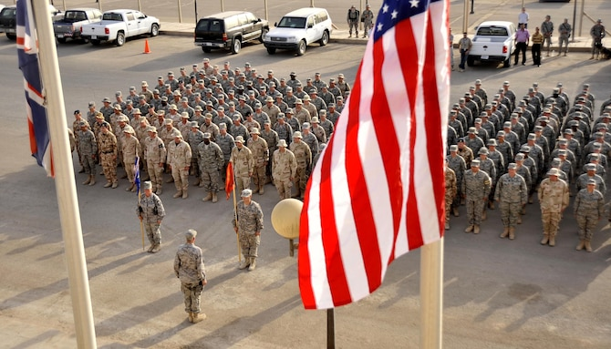 Soldiers, Airmen and Royal Air Force members stand in a joint formation for a ceremony on the seven-year anniversary of the terrorist attacks of Sept. 11, 2001, Sept. 11 at Sather Air Base, Iraq. (U.S. Air Force photo/Master Sgt. Brian Davidson)