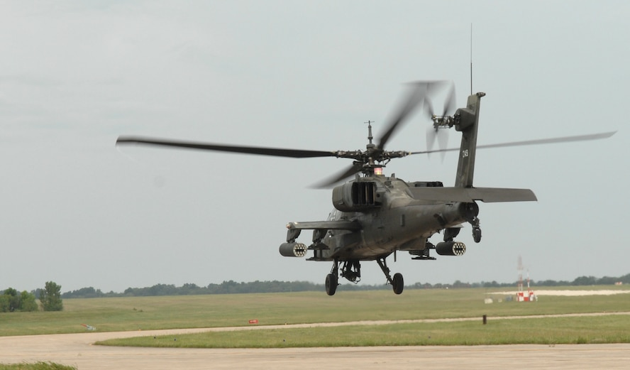 WHITEMAN AIR FORCE BASE, Mo. – AH-64A Apache takes off after being loaded to fire its munitions at Ft. Leonard Wood Sept. 6. The Missouri Army National Guard's 1-135th Attack Recon Battalion recently implemented a new training program that allows pilots to arm and fly three AH-64 Apache helicopters from Whiteman AFB to Fort Leonard Wood for the first time to practice aerial gunnery at their monthly drill. (U.S. Air Force photo/Senior Airman Stephen Linch)