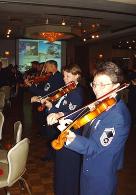MCGUIRE AIR FORCE BASE, N.J. -- Violinists with the  Air Force Strolling Strnigs provide entertainment during the 514th Air Mobility Wing's Military Ball held Sept. 6 at the Grand Varsailles Ballroom located in Mount Laurel, N.J. Close to 450 military members, retirees and guests celebrate the 60th Anniversary of the Air Force Reserve. (U.S. Air Force photo/Master Sgt. Derek Williams)