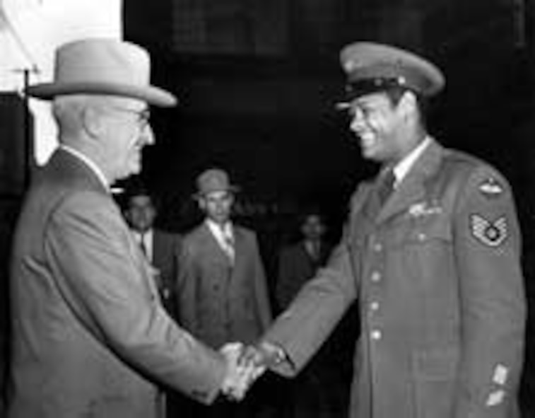 U.S. Air Force Staff Sergeant Edward Williams of St. Louis, exchanges a hearty handshake with his Commander-in-Chief, President Harry S. Truman, Oct. 13, 1950, at a casual meeting during the President's morning walk. Williams had been in the Air Force nine years at the time of this photograph. (Courtesy photo)