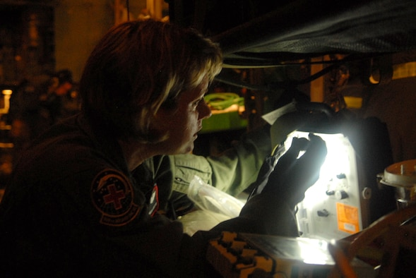 LITTLE ROCK AIR FORCE BASE, Arkansas --.  Senior Airman Melinda Ford goes through pre-flight procedures before takeoff to Beaumont, Texas, September 12, 2008. Patients are being transported from Beaumont, Texas to Lackland Air Force Base, Texas by a combined effort from the 61st Air Wing C-130 aircraft and crews Little Rock Air Force Base and the 908th Aero medical Evacuation Squadron Scott Air Force Base, IL in preparation for Hurricane Ike's landfall in southern Texas.  (U.S. Air Force photo by Staff Sgt. Chris Willis) (RELEASED)