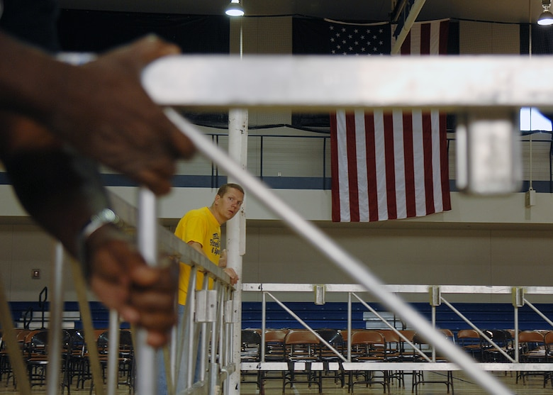 "Senior Airman Jason Daffern, 49th Force Support Squadron, helps set up the boxing ring for ""Raptor Rumble 2,"" Sept 12. Raptor Rumble is an annual boxing event held at Holloman for Air Force Service members to participate in amateur boxing. The Raptor Rumble event will be held at the Fitness Center.