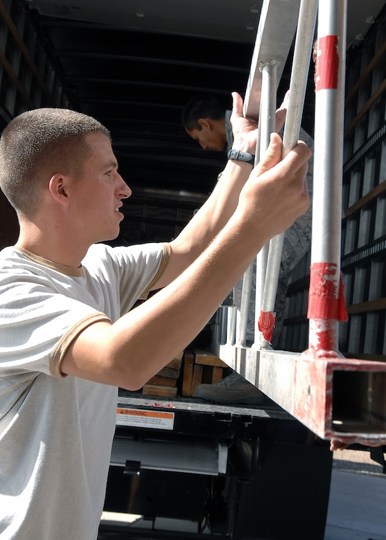 "Airman 1st Class William Schull, 49th Communications Squadron, helps unload and set up the boxing ring for ""Raptor Rumble 2,"" Sept 12. Raptor Rumble is an annual boxing event held at Holloman for Air Force Service members to participate in amateur boxing. 