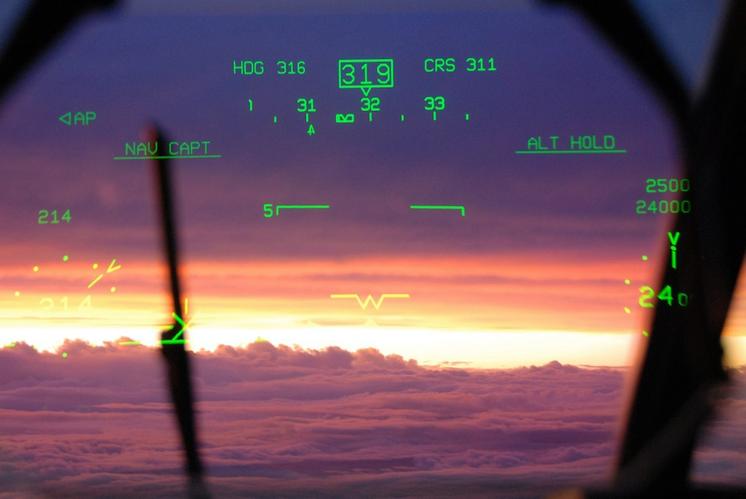 A pilot's view of sunset through the heads-up display after flying into Hurricane Ike Sept. 10 over the Gulf of Mexico. The Air Force Reserve Hurricane Hunters of the 403rd Wing at Keesler Air Force Base, Miss, fly 24-hours-a-day, collecting data inside the heart of Hurricane Ike. The data collected by the Hurricane Hunters improve the National Hurricane Center forecast by 30 percent. (U.S. Air Force photo/Maj. Chad E. Gibson)