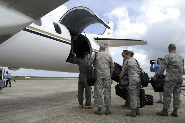 Members of the AFNORTH ACCE team stow their cargo prior to the team's deployment in support of anticipated relief efforts for Hurricane Ike.  The Air Component Coordination Element is a group of Air Force subject matter experts that coordinates the movement of Air Force assets into stricken regions during natural disasters or other contingencies.  The team also supports state and federal evacuation, humanitarian relief and search and rescue missions. (U.S. Air Force photo by Master Sgt. Jerry Harlan)